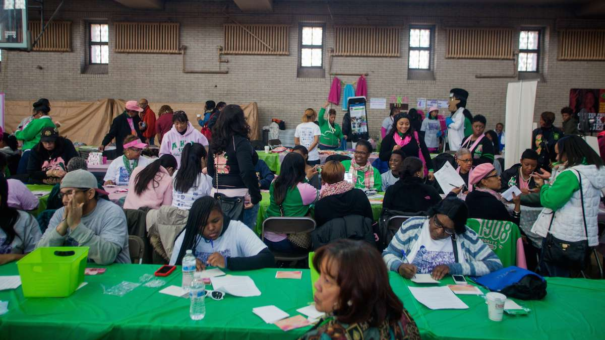 At a job and services fair at Girard College on Martin Luther King Day Philadelphians worked on applying for jobs and writing resumes. (Brad Larrison for NewsWorks)