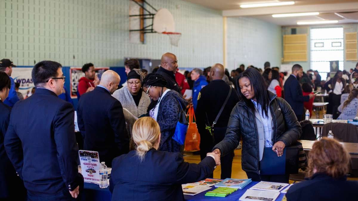 The Philadelphia Fire Department tabled and looked for new recruits at a job and services fair at Girard College on Martin Luther Kind Day. (Brad Larrison for NewsWorks)