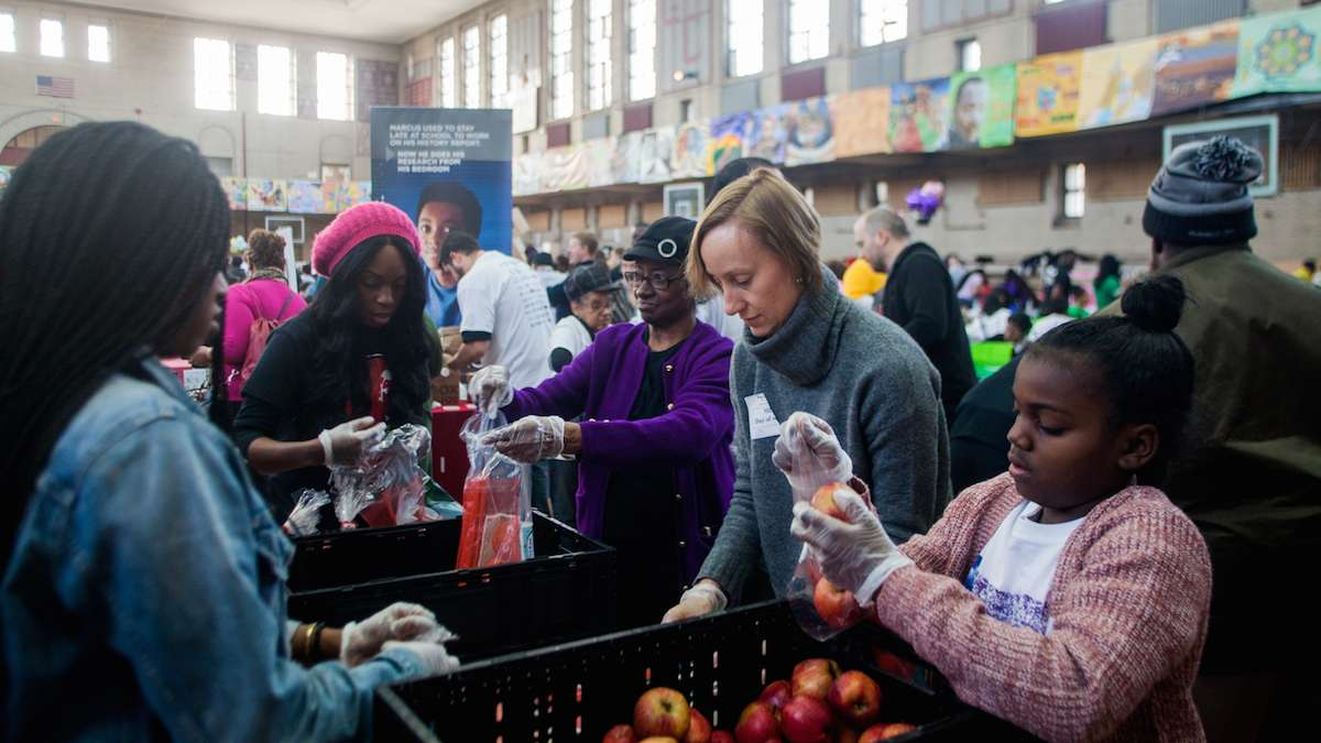 Volunteers with Philadbundance packaged apples at Girard College on Martin Luther King Day. (Brad Larrison for NewsWorks)