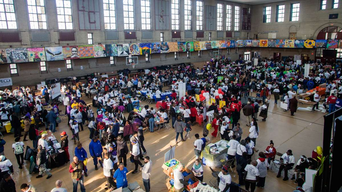 Philadelphians walk through a job and services fair at Girard College on Martin Luther King Day 2017. (Brad Larrison for NewsWorks)