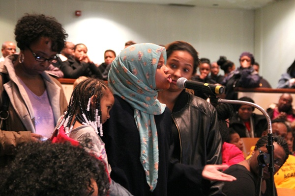 <p>In the crowded auditorium at Martin Luther King High School, Dobbins High School ninth grader Siani Whitehead urges administrators to keep her school open. (Emma Lee/for NewsWorks)</p>