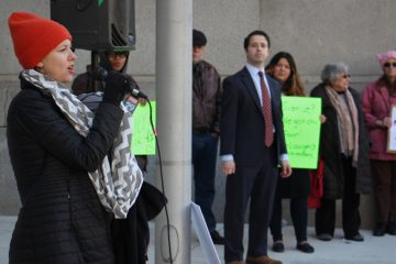Pennsylvania ACLU lawyer Molly Tack-Hooper speaks at a rally in support of immigrants outside City Hall. Many people go through immigration court without an attorney. (Emma Lee/WHYY, file)
