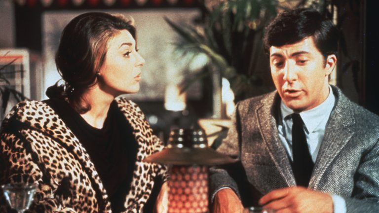 In this publicity still, actors Anne Bancroft and Dustin Hoffman appear in a scene from the 1967 film