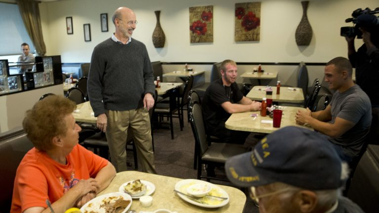 Pennsylvania Democratic Gov.-elect Tom Wolf  greets people at a cafe after winning the gubernatorial election. (AP Photo/Matt Rourke)