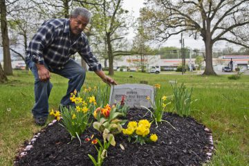 Neil Butler maintains his mother's grave and often volunteers to help upkeep Mt. Peace Cemetery in Lawnside, N.J. (Kimberly Paynter/WHYY)