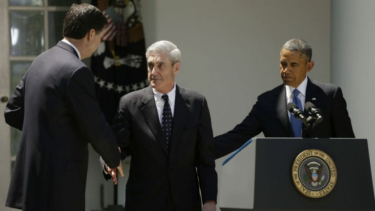 FBI Director Robert Mueller, center, shakes hands with James Comey, center, as President Barack Obama, right, looks on in the Rose Garden of the White House in Washington, Friday, June 21, 2013, where the president announced would nominate Comey, a senior Justice Department official under President George W. Bush, to replace Mueller as FBI director. (AP Photo/Pablo Martinez Monsivais)