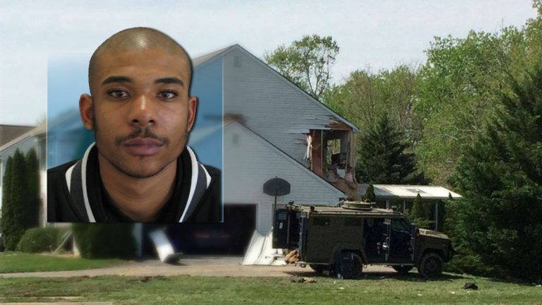 Burgon Sealy was arrested nearly four years ago on gun and drug charges in Florida. He was killed by police following a nearly 20 hour standoff at his Middletown home. (Sealy photo courtesy Del. State Police/home photo: Shirley Min/WHYY)
