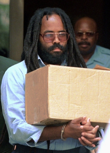 In this July 12, 1995 file photo, Mumia Abu-Jamal leaves Philadelphia's City Hall after a hearing. A federal judge in Pennsylvania has blasted a prison policy that denies former death-row inmate Abu-Jamal and others an expensive hepatitis C drug until they have advanced liver damage. Abu-Jamal is serving a life term for the 1981 killing of a Philadelphia police officer. He is a former Black Panther and radio reporter. (Chris Gardner/AP Photo, file)