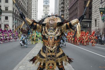 The Fralinger String Band concludes their performance at Broad and Sansom Streets. (Jonathan Wilson for WHYY, file)