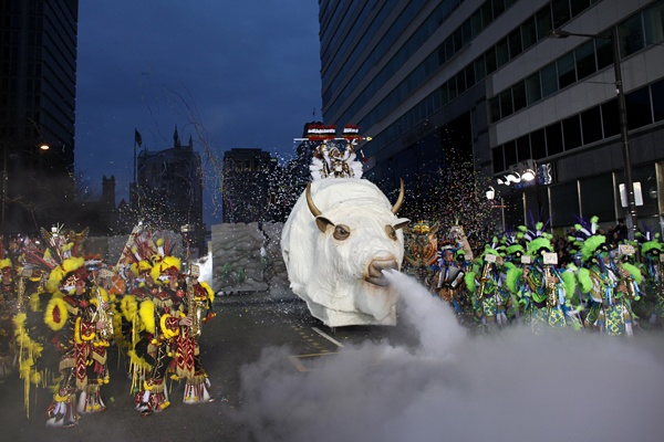 <p>Members of the Quaker City String Band perform for judges during the 113th annual Mummers Parade in Philadelphia, on Tuesday Jan. 1, 2013. (AP Photo/Joseph Kaczmarek)</p>