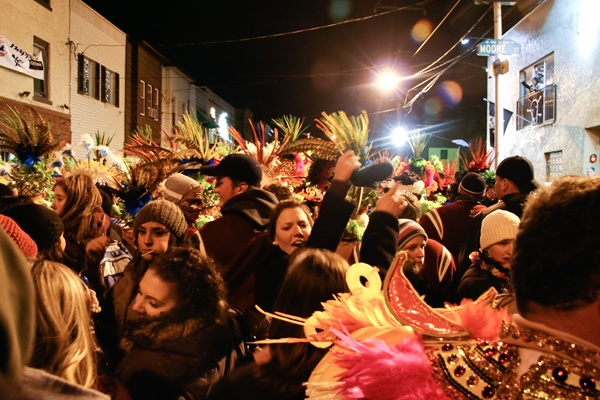 <p><p>Mummers intermingle with revelers as barriers are broken down, literally and figuratively, on narrow 2nd Street in South Philly. (Image courtesy of Kate Devlin)</p></p>