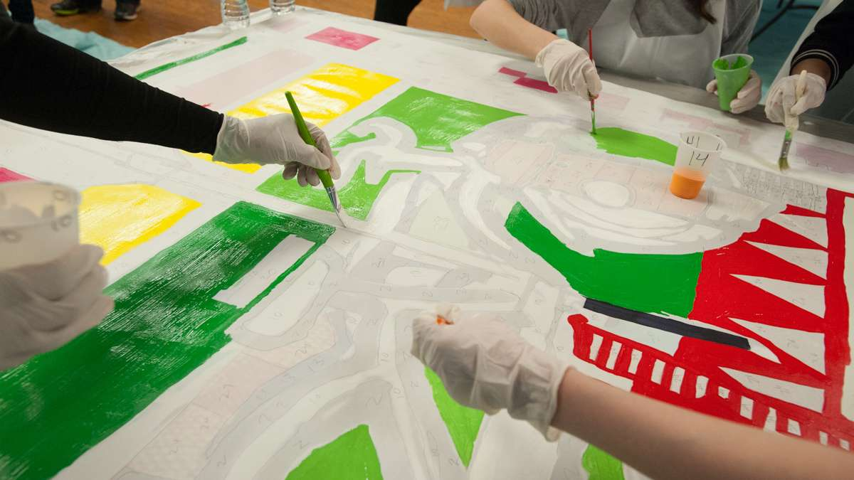 The paint-by-number canvases made painting the mural a simple process for the volunteers. (Jonathan Wilson for