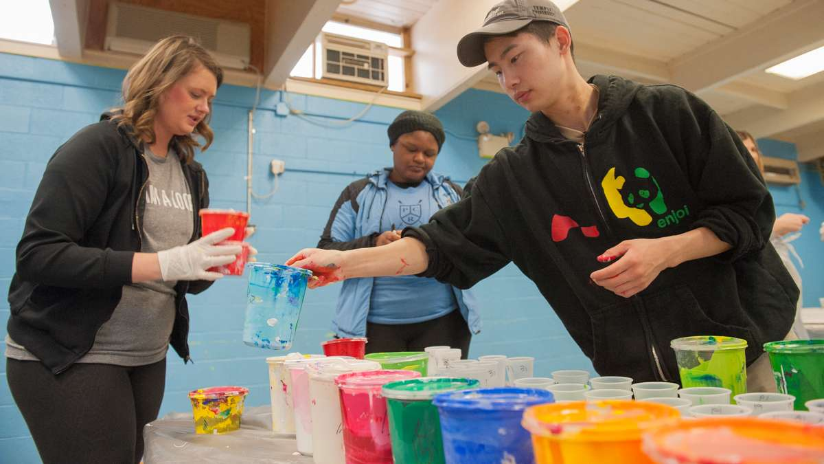 At Capotolo Playground Center in South Philadelphia (from left) Ann Kramer, Meniyah Miller, and Alex Kim prepare paint.