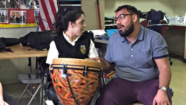 Juan Zambonini (right) sings with a student at Edison High School during a music therapy class. (Avi Wolfman-Arent/WHYY)