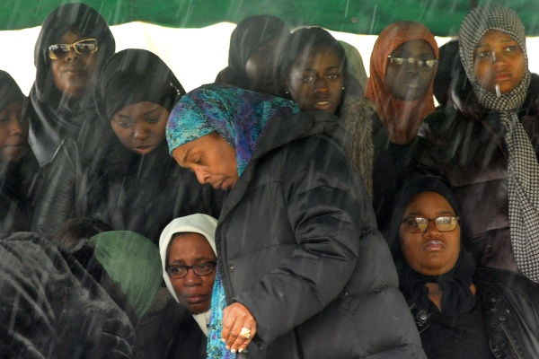 <p>&lt;p&gt;Rain begins to fall at the gravesite as Leslie Glenn, left, sits with Najji's fianc&#xE9;e Lashawn Brown, right, who is six months pregnant. Funeral director Khadijah Alderman, foreground, attends to the burial. (Peter Tobia/for NewsWorks)&lt;/p&gt;</p>