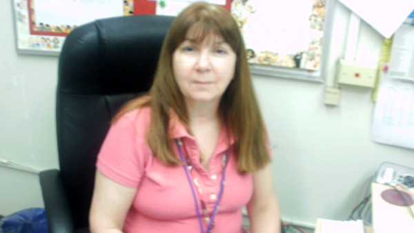 Nancy Henry is a pediatric nurse practitioner who has worked full time for 14 years at Taggart Elementary School, which has 485 students (grades K-8), including three classes of students with multiple handicaps. (Image courtesy of Sharon Smith.)