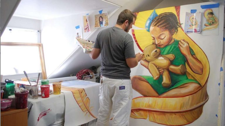 Check out Queen Muse's story on mural artist Nathaniel Lee, shown here. (Courtesy of Nathaniel Lee)