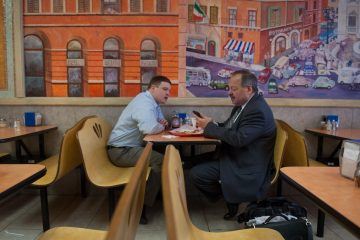 Nelson Diaz and communications director Barry Caro discuss talking points over lunch at Ciao Pizza in center city before a string of evening events on Thursday.