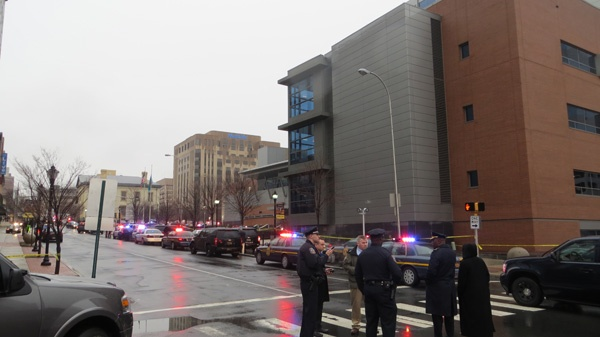 <p><p>Police gather outside the New Castle County Courthouse in Wilmington after the 8am shooting. (Mark Eichmann/WHYY)</p></p>