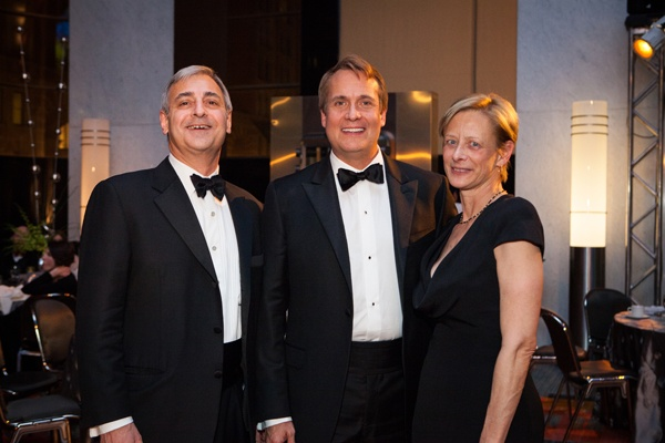 Board member Peter Leone (left) and his wife Judy Leone with tenor William Burden (center), whose role of the German opera singer Nikolaus Sprink in Silent Night was underwritten by the Leones (Photo courtesy of Sofia Negron Photography)