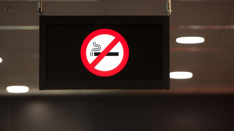 No smoking sign hangs from a ceiling. (jhphotos/Bigstock)
