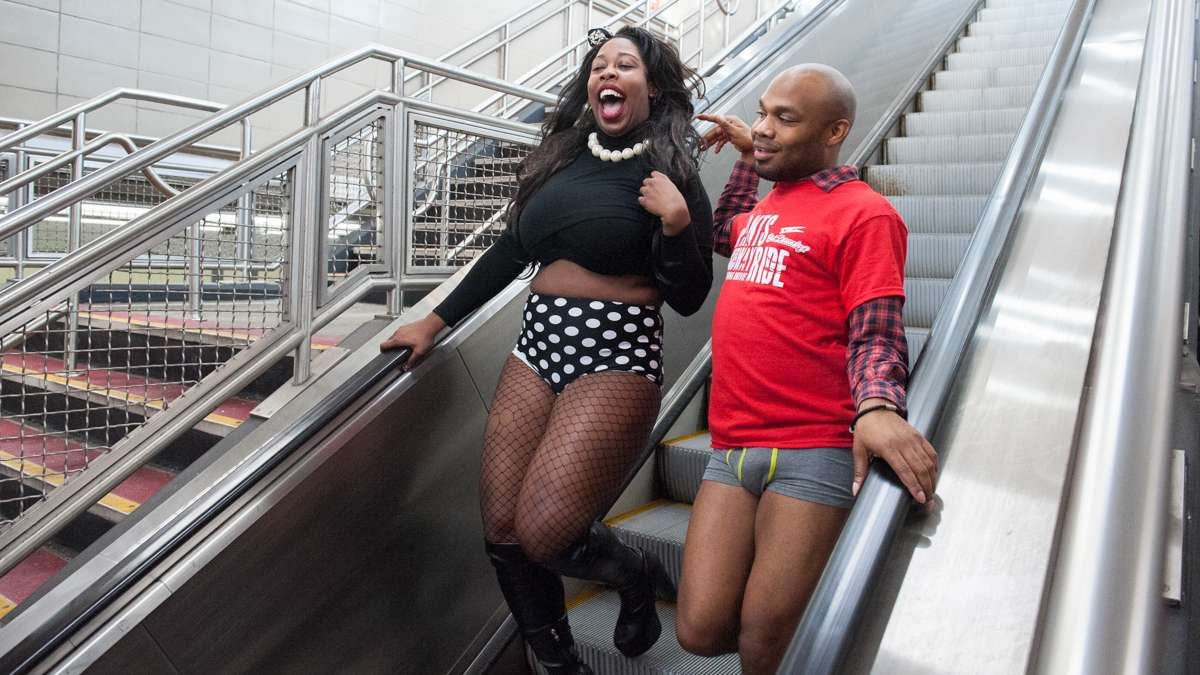 India White (left) and Darnell Squire descend the escalator at the AT&T subway station.