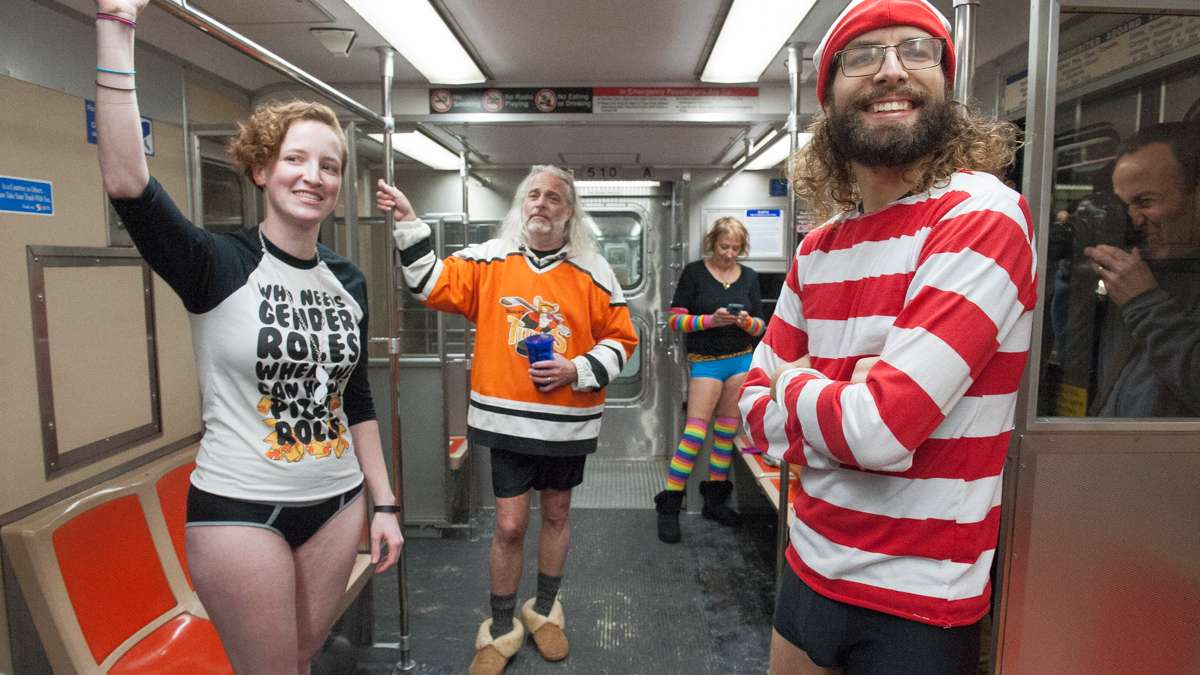 From left Koryn, Andrew Kerr, Peggy Kerr and Waldo watch the No Pants participants celebrating on the Broad Street subway.