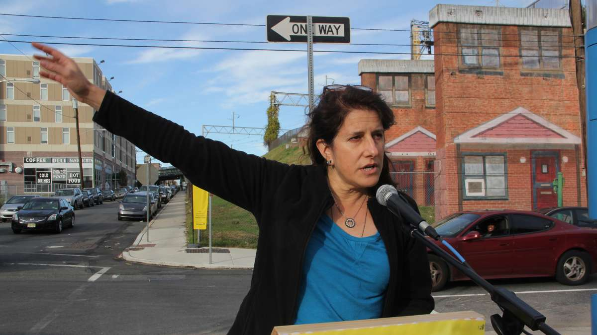 Artist Jennie Shanker speaks at the dedication of her work, Norris Homes Historical Marker, produced as part of the Mural Arts Open Source project. (Emma Lee/WHYY)