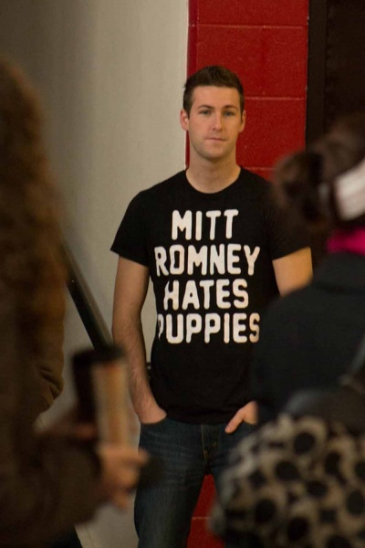 "<p><p>A voter at North Light Community Center sports a shirt that says ""Mitt Romney hates puppies."" (Francis Hilario/for NewsWorks)</p></p>"