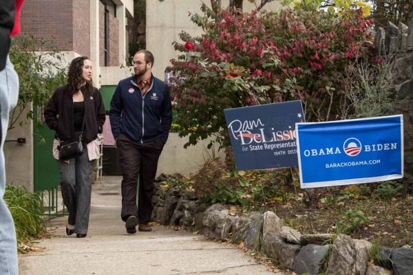 <p><p>A couple walks towards the Roxborough Library to cast their votes in the 2012 General Election. (Francis Hilario/for NewsWorks)</p></p>