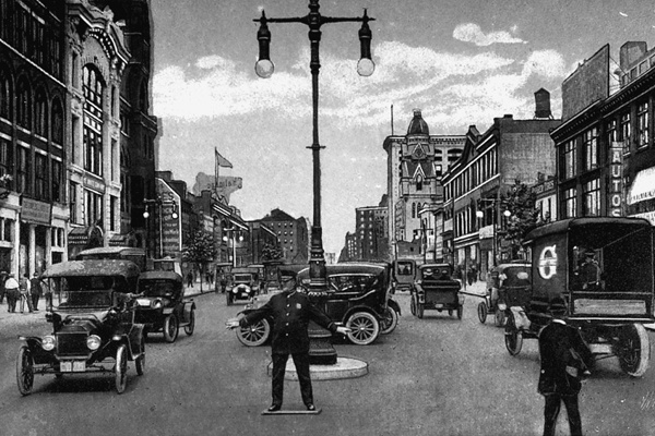 <p><p>A policeman is shown directing traffic on North Broad and Race streets in this 1915 postcard. (Historical image courtesy of Arcadia Publishing.)</p></p>