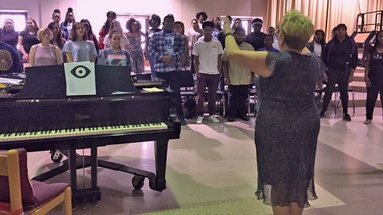 CAPA choral director Dorina Morrow leads a choir of students. (Avi Wolfman-Arent/WHYY)