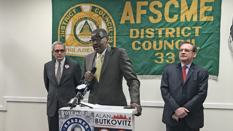 Peter Matthews, president of  District Council 33 of the American Federation of State, County and Municipal Employees, announces the union's support for Larry Krasner (left) in the race for Philadelphia district attorney and incumbent Alan Butkovitz (right) for city controller.  (Bobby Allyn/WHYY)