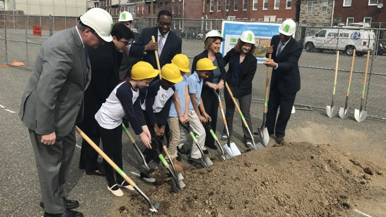 Philadelphia Mayor Jim Kenney, Council President Darrell Clarke, Schools Superintendent William Hite and others break ground for a schoolyard with students from the Alexander Adaire School, where the public green space will be located in Philadelphia's Fishtown section.  (Bobby Allyn/WHYY)