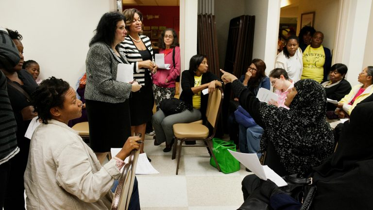 Members of the Wister Elementary School community hear a pitch from district staffers on a proposed charter conversion at an October meeting in Germantown. (Bastiaan Slabbers/for NewsWorks)