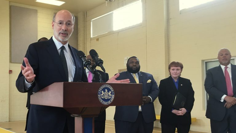 Pennsylvania Gov. Tom Wolf and local officials discuss funding for senior services at the Wilson Park Senior Center in South Philadelphia. (Dave Davies/WHYY)