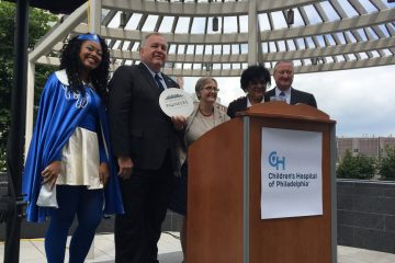 Mayor Jim Kenney congratulates CHOP officials on being named 'storm water pioneers' for 2017. (Danielle Fox for NewsWorks)