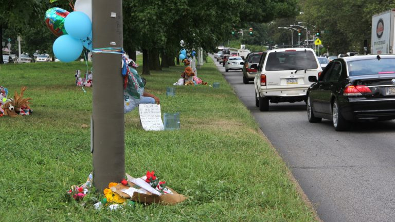 Memorials mark the area of Roosevelt Boulevard near 2nd Street where Samara Banks and three children were killed as they attempted to cross the 12-lane roadway. (Emma Lee/WHYY)