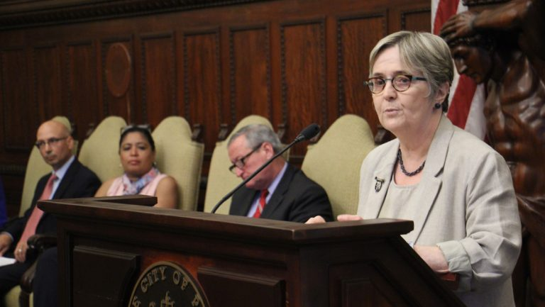 Philadelphia Water Department Commissioner Debra McCarty explains a new program that will help low-income residents reduce their water bills. (Emma Lee/WHYY)