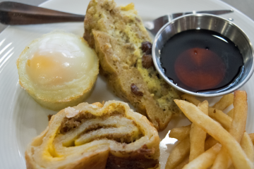 A sampling of Thrive Dining foods available at the Logan Square Watermark Retirement Community, include cheese steak,baked egg, a French toast casserole and fries (Liz Tung for NewsWorks)