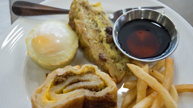 A sampling of Thrive Dining foods available at the Logan Square Watermark Retirement Community, include cheese steak,baked egg, a French toast casserole and fries (Liz Tung for WHYY)