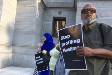 Community members pay hold signs saying 'Justice for Nabra' and 'Stop Profiling Muslims' during a candlelight vigil held in Philadelphia for Nabra Hassanen, the 17-year-old Muslim woman from Sterling, Va., who was beaten to death with a baseball bat early on June 18. (Danielle Fox for NewsWorks)