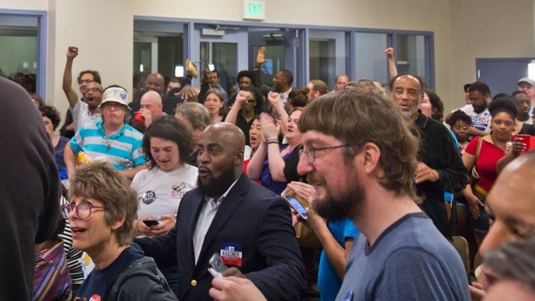 Supporters of Democratic primary winner Larry Krasner react to the news of his winning at Krasner's campaign party Tuesday night. (Kimberly Paynter/WHYY)