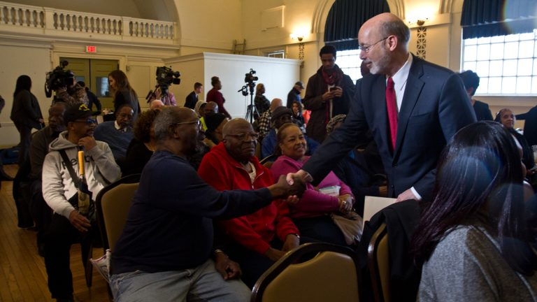 Pa. Governor Tom Wolf shakes hands with Center member Robert Gordon. (Kimberly Paynter/WHYY)