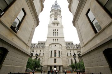 The clock tower of Philadelphia City Hall is seen form the building's courtyard. (Nathaniel Hamilton/for WHYY, file)