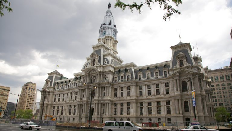 Philadelphia's City Hall, seen under a clouded sky. Those holding city office must continue following the
