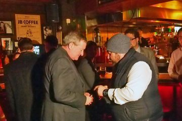 Former Philadelphia councilman and current mayoral candidate Jim Kenney (left) speaks with an attendee at an event held by the Philadelphia Democratic Progressive Caucus (Shai Ben-Yaacov/WHYY)