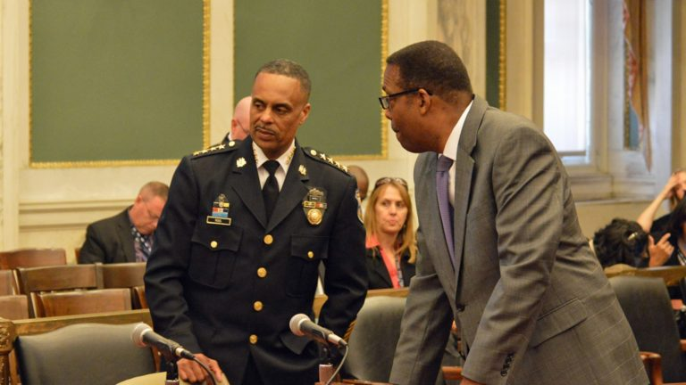Philadelphia Police Commissioner Richard Ross (left) and  Council President Darrell Clarke speak before a Tuesday budget hearing. (Tom MacDonald/WHYY)