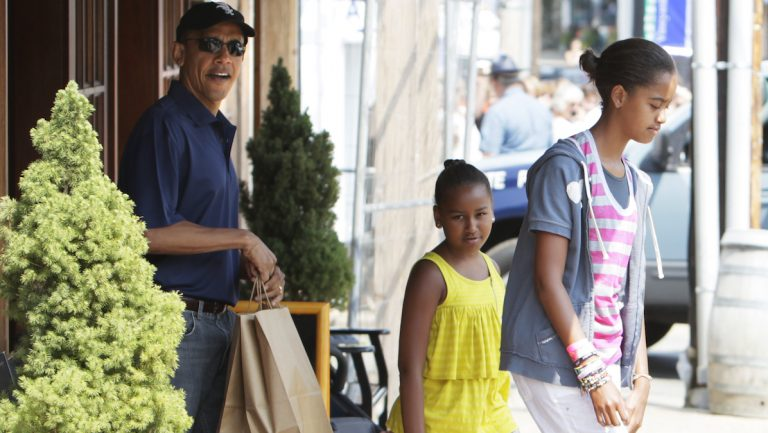 President Obama shopping with his daughters during the family's 2010 vacation to Martha's Vineyard, MA.  (AP Photo/Carolyn Kaster)