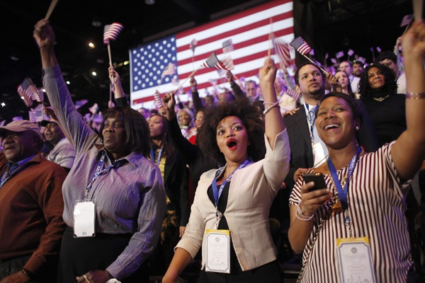 <p>Supporters of President Barack Obama react to favorable media projections at the McCormick Place during an election night watch party in Chicago on Tuesday, Nov. 6, 2012. (AP Photo/Jerome Delay)</p>